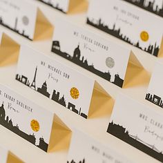 Wanderlusting hosts can share their favorite vacation spots with destination-themed place cards.