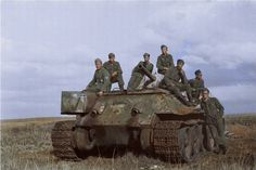 German troops on board an abandoned Soviet T34/76 tank, in a field in the Belgorod Region of Russia, about 40 kilometres north of the border with Ukraine. 1943. The Photographer, Franz Karl-Heinz Grasser of the 167th Infantry Division, was posted to the Ukraine in 1943 and died in Soviet captivity Novorossiysk, Krasnodar Krai on November 13 1944. (Colorised by Georgiy Stanislavskiy from the Ukraine)