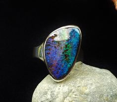 Boulder Opal Ring OR-011. This stone is SO PRETTY. It would probably feel too big on my hand, though. :(