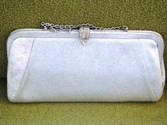 1950s silver lame' clutch with silver chain and marcasite snap etsy shop- VintageAngeline, $25.00