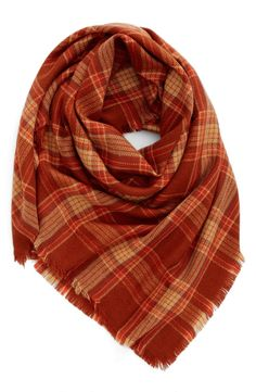 Bringing a woodsy vibe to any fall ensemble with this plaid scarf that would pair perfectly with a cream sweater and dark denim. On Anniversary Sale.