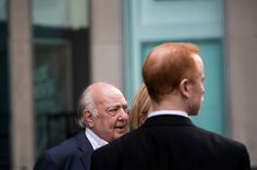 Security stands in front of Fox News chairman Roger Ailes as he leaves the News Corp building, July 19, 2016 in New York City. As of late Tuesday afternoon, Ailes and 21st Century Fox are reportedly in discussions concerning his departure from his position as chairman of Fox News. (Photo by Drew Angerer/Getty Images)