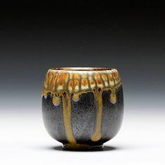 Sebastian Moh Description: porcelain with ash over tenmoku glaze