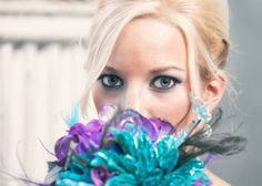 Bridal pictures. Turquoise. Purple. Peacock. Old Sacramento. California.