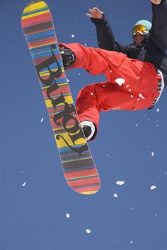 Snowboard jumping on Vogel mountain Photograph