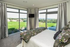 Stretch out side from this guest bedroom, complete with ensuite bathroom and wardrobe. One of three bedrooms with ensuite bathrooms in the home Ensuite Bathrooms, Bedroom With Ensuite, Outdoor Furniture, Outdoor Decor, Custom Design, Curtains, Modern, Bedrooms, House