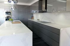 Harrington Kitchens Marble / Carrara stone look benches with dark grey cabinetry Custom Made Furniture, Furniture Making, Calacatta Nuvo, Carrara, Kitchen Tops, Kitchen Ideas, Stone Countertops, Commercial Interiors, Bathroom Renovations