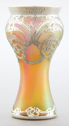 A LOETZ GLASS VASE WITH LA PIERRE SILVER OVERLAY   Glasfabrik Johann Loetz Witwe, Klostermuhle, Austria, circa 1900  Silver by La Pierre Mfg. Co., New York, New York & Newark, New Jersey   Marks to silver: L, STERLING