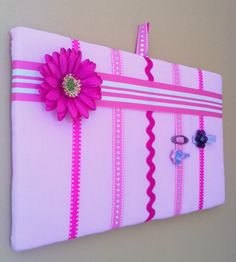 Wall art and hair clip accessory storage board by BoardStiff2. $20.00, via Etsy.