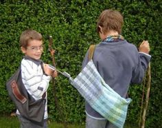 Homeschooling Boys with their bows and arrows, a must try when we get a house with back yard.