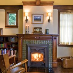 Beautiful tile and wood fireplace with sconces. doesn't fit our home, but lovely and simple