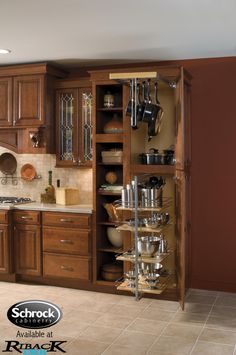 Utility Storage with Pantry Pullout and Pots & Pans Rack -- makes finding what you want that much easier!