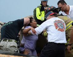 Rescue workers help free one of the 15 people that were trapped at a medical building at the Moore hospital complex after a tornado tore through the area