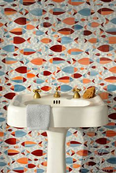 Floating Fish, a water jet jewel glass mosaic shown in Mica, Sardonyx, Garnet, Pearl, and Quartz, is part of the Erin Adams Collection for New Ravenna Mosaics.
