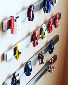 How incredibly genius is this idea! Get some metal strips to hang metal toys (such as race cars) on the wall. Way better than stepping on them! #organizingtips : Pinterest
