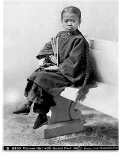 19th century photograph of young girl with bound feet and lotus shoes. Photo by I. W. Taber