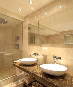 Limestone bathroom with egg sinks - Definitive Interior Design- love warm but light tones Taupe Bathroom, Downstairs Bathroom, Bathroom Inspo, Master Bathroom, Bathroom Ideas, Design Bathroom, Bed In Closet, Hotel Room Design, Bathroom Renovations