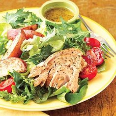 Lemon-pepper light tuna adds protein to this salad bowl meal. Using refrigerated potato wedges and garlic vinaigrette makes this a quick, easy dinner.