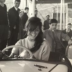 Claudia Cardinal riding in bumper cars, c. 1966.