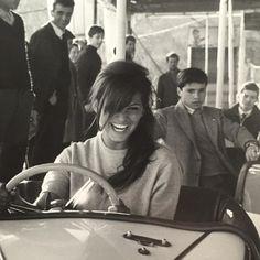 Claudia Cardinal riding in bumper cars, c. 1966.