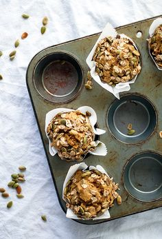 The perfect fall breakfast - tahini pumpkin muffins! Topped with a pepita oatmeal crumble and just lightly sweetened - delicious for breakfast or dessert!