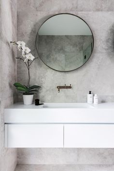 """<b>Bathroom</b> To create more space, a bath was removed and the door opening moved to fit a double vanity by <a href=""""http://www.ispacesolutions.com.au/"""" target=""""_blank"""">iSpace Solutions</a>. """"We used weathered brass tapware that will eventually develop a patina – a look that we love,"""" says Nikki. Brodware 'yokato' tapware, <a href=""""https://candana.com.au/"""" target=""""_blank"""">Candana</a>. <a"""