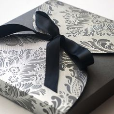 Silver and pewter presentation box for some beautiful wedding invites. We like to make first impressions last! #weddinginvitation #weddinginspiration #wedding #luxuryinvitation #custominvitation #silver #modernwedding #packaging #design #graphicdesign #beauty