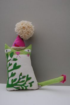 Textile art ornamental cat doll called Mistletoe