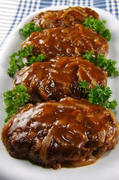 Salisbury Steak with Caramelized Onion Gravy - Salisbury Steak is one of the retro foods that has made a comeback in American kitchens.