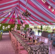 Elegant carnival or Mad Hatter themed party with multi-colored ceiling drape by Revelry Event Design