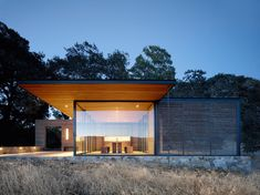 Walker Warner Architects has created a trio of pavilions at a California winery with operable glass walls that enable rooms to be open to the outdoors.
