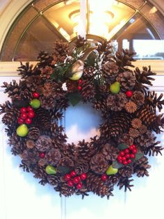 Inviting Christmas pinecone wreath by ItsTheHolidays on Etsy, $80.00