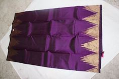 Wine colour traditional kanjeevaram saree with temple border