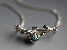 Blue zircon and twig pendant,
