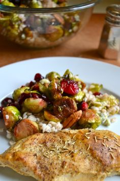 The Worlds Best Chicken by Rachel Schultz  Pan seared brussel sprouts w/cranberries & pecans to go with the worlds best chicken...