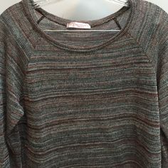 """Chris and Carol Sweater I love the colors in this lightweight sweater.63% polyester 33^ rayon 4% metallic. Worn but in perfect condition. The sleeves I don't know if they are meant to be rolled or why they are seen like that. Length is 24"""" across is 17"""" Chris and Carol Sweaters"""