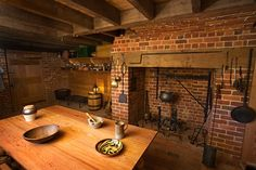 colonial fireplace cooking | large hearth in the cellar suggests cooking was done on the ...