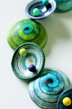 Blue and green polymer clay necklace by Silvia Ortiz de la Torre | Flickr. Handmade jewelry, artisan necklace, disc necklace, alcohol inks, spiral beads