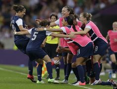 United States' Carli Lloyd, left, celebrates with teammates after scoring her second goal during the women's soccer gold medal match against Japan.