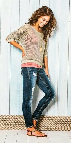 Cute outfit and pretty curly hair!  Open knit sweater, cami and skinny jeans