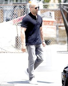 Transporter star Jason Statham looking every inch the action star that he is in a fitting black t-shirt and gray jeans. His rugged yet stylish look was completed with a pair of black aviator style sunglasses. via dailymail.co.uk