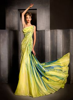 I'd have to be about 12 inches taller to get away with wearing this dress but a girl can dream!  Blanka Matragi Haute Couture 2012