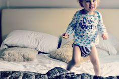 He's not naughty, he's learning! My little monkey jumping on the bed