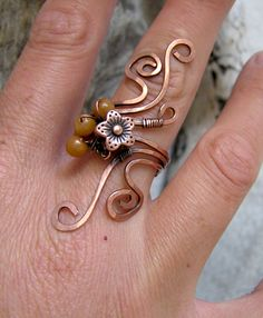 I can see this with turquoise -- I love copper and tq together. The length of this ring is nicely calculated.