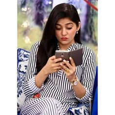 Sanam Baloch useing smart phone