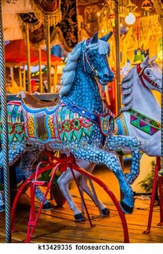Carousel. Horses on a carnival Merry Go Round. View Large Photo Image