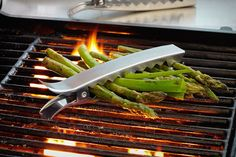 GRILL CLIPS  Keep your veggies in check when you're grilling them up with Grill Clips ($15/4-pack). These smart metal clips pack enough holding power to grip entire groups of asparagus, zucchini, green onions, peppers, and pretty much any other food you can think of that's prone to rolling around and/or potentially falling through the grate to a fiery doom
