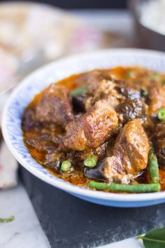 Slow Cooker Thai Red Beef Curry from Sara Lewis's Ultimate Slow Cooker. Not your average slow cooker curry. | The Cook's Pyjamas. Note: Uses beef stew meat, eggplants, red Thai curry paste, fish sauce, coconut milk and kaffir lime leaves.