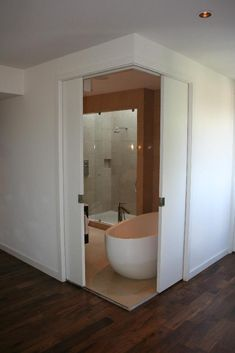 Corner Pocket doors, for ensuite bathroom. In my dream home, *all* the doors are pocket doors. Ensuite Bathrooms, Bathroom Doors, White Bathroom, Master Bathroom, Door Design, House Design, Corner Door, D House, Pocket Doors