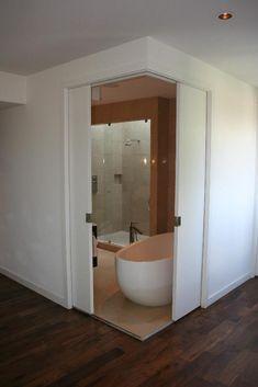 Pocket doors, for ensuite bathroom. In my dream home, *all* the doors are pocket doors.